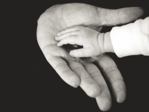 baby-girl-and-dad-hands