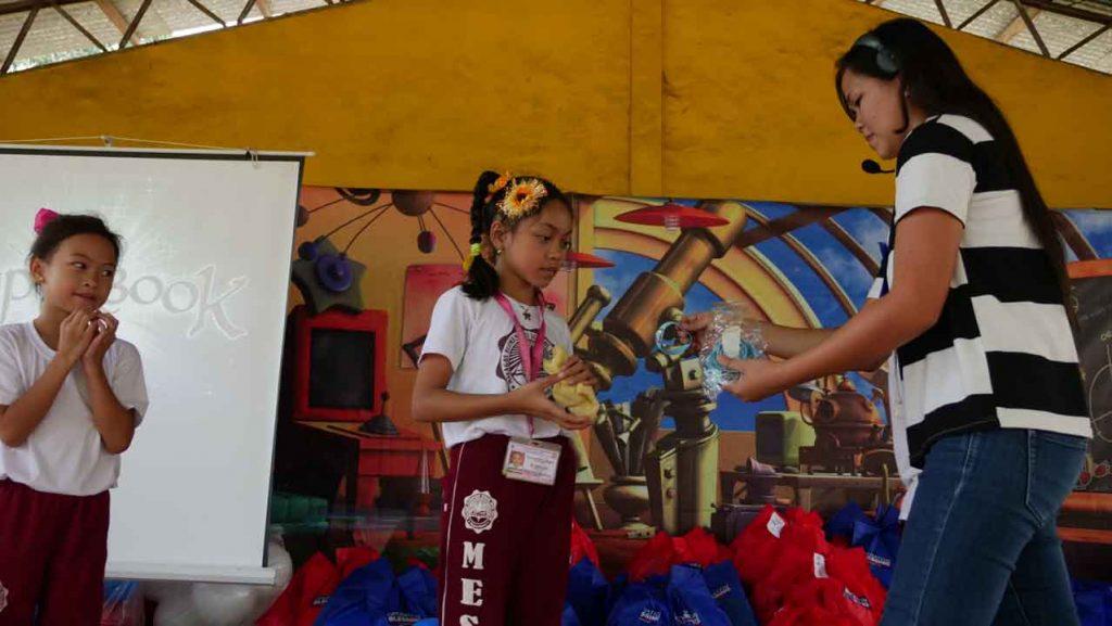 GIRL RECEIVING PRIZES