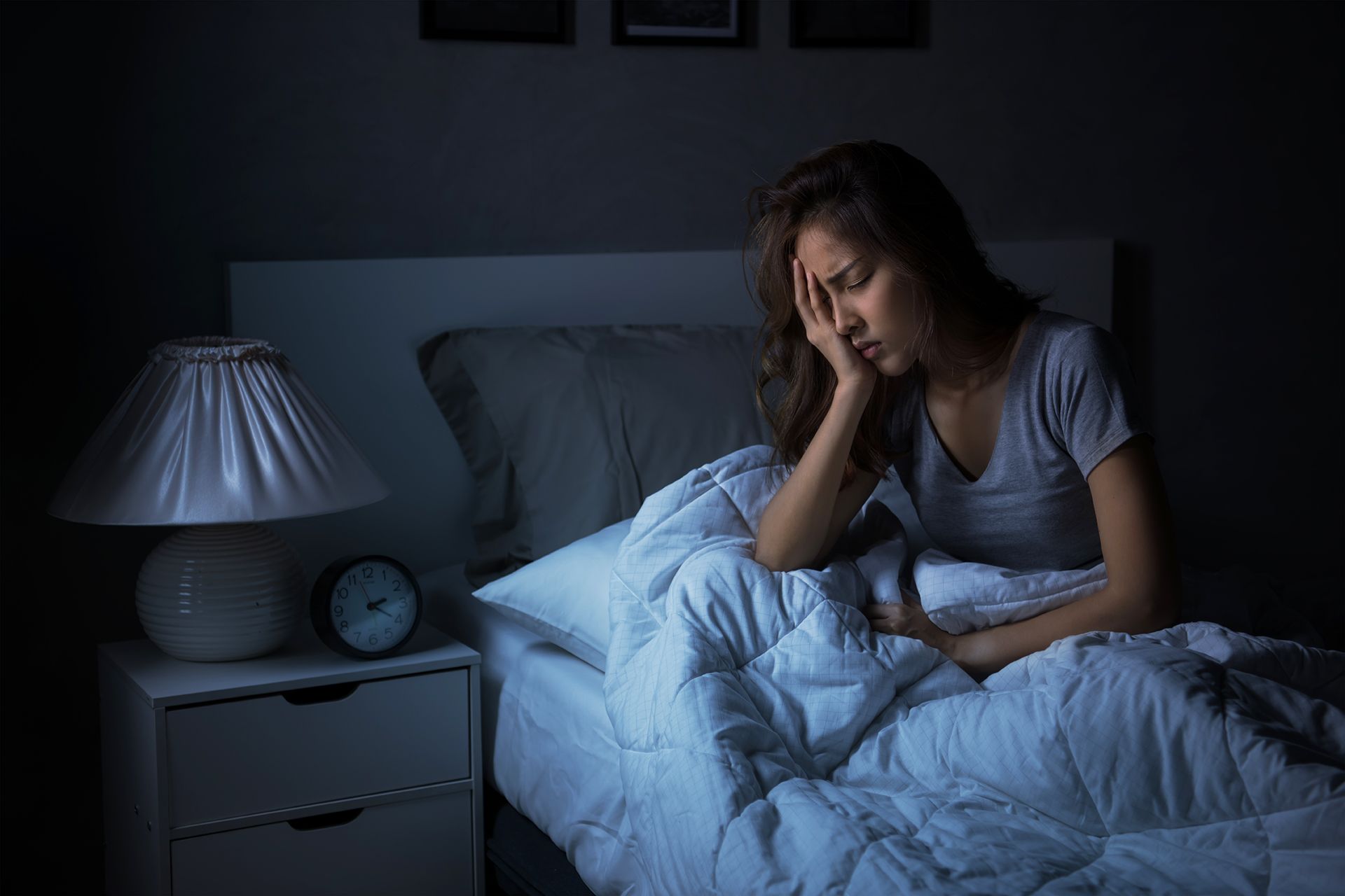Depressed young Asian woman sitting in bed cannot sleep from insomnia - CBN  Asia Family of Ministries